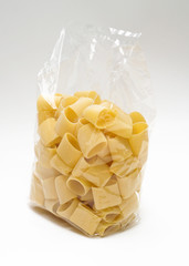 "Transparent plastic pasta bag ""paccheri"" on white background"