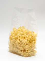 "Transparent plastic pasta bag ""tagliatelle girate."" on white background"