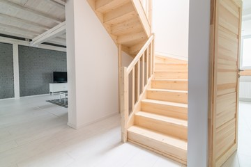 Pine stairs in hall.