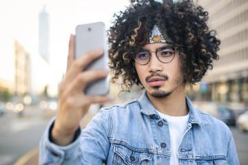 Cool guy making a selfie