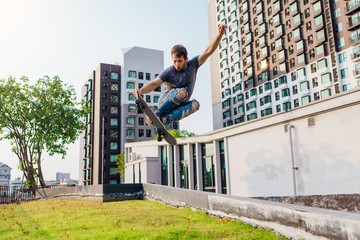 Young man on a skateboard jumping high and making trick