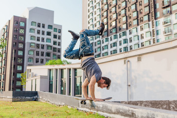 Skateboarder handstand on ramp