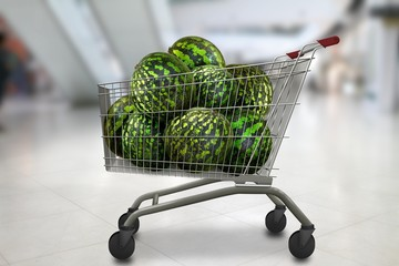 watermelons in the shopping cart at bokeh blurred shop background. Organic vegetarian food.