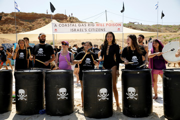 Israeli protestors, together with hundreds of Israeli surfers, take part in what they said was a record-breaking protest against potential environmental damage from an off-shore gas development project in the Mediterranean Sea at Herzliya
