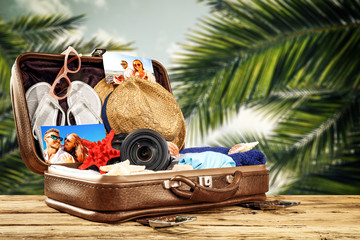 summer suitcase and photo of people