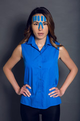 girl with with kinesio tape on her face