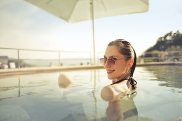 Smiling woman in the pool