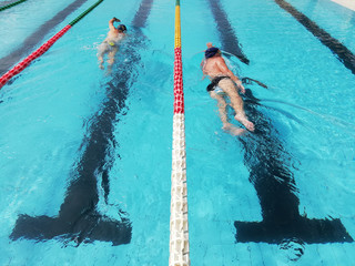 swimmers in lane pool, men in water
