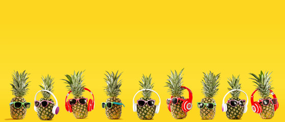 Poster Vruchten Summer photo of pineapple and yellow background of free space for your text.