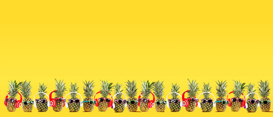 Summer photo of pineapple and yellow background of free space for your text.
