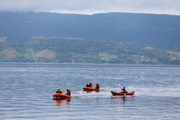 Rescue team members are using rubber boats during the operation to find the missing passengers, after a ferry sank earlier this week in Lake Toba in Simalungun