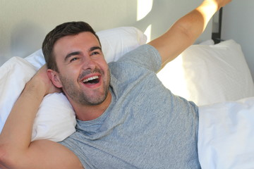 Satisfied male waking up with positivity