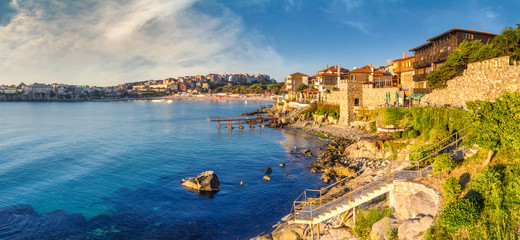 Coastal landscape banner, panorama - embankment with fortress wall in the city of Sozopol on the Black Sea coast in Bulgaria Wall mural