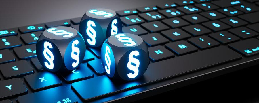 Leuchtende Würfel mit Paragraphen-Symbol auf Tastatur