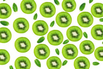Creative layout made of Kiwi fruits snd mint leaves. Many slices of ripe and juicy Kiwifruit. Flat lay.