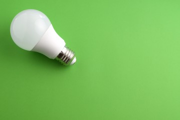 White lightbulb on a green background