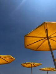 Yellow beach umbrellas in the sun
