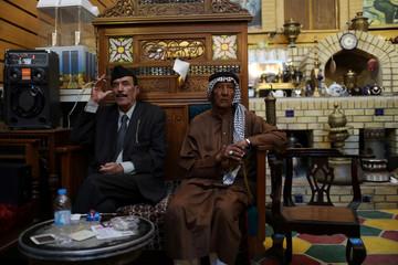 Residents sit in a popular cafe at al-Mutanabi Street in Baghdad