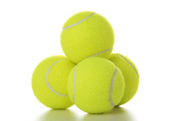Stack of tennis balls isolated