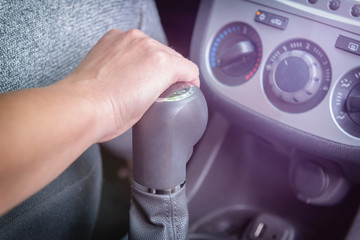Hand on gear shift lever