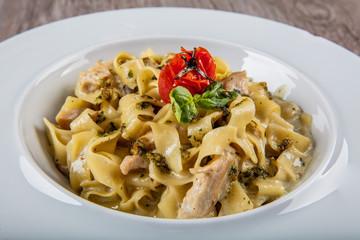Fettuccine Alfredo Pasta with mince and tomato, italian food.