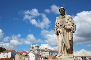 Sculpture of Sao Vicente (St. Vincent of Saragossa), Lisbon's Patron Saint, with Igreja de Sao Vicente de Fora in the Background. Lisbon. Portugal