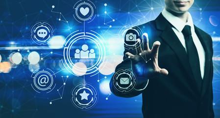 Social Media with businessman on blurred blue light background