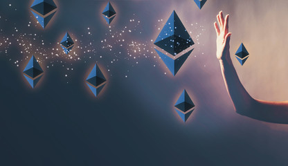 Ethereum with a hand in a dark light background