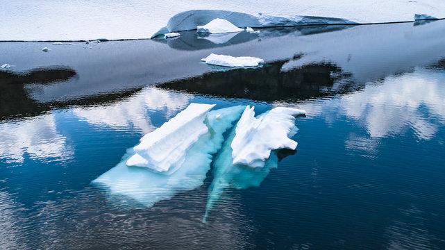 Melting ice in mountain lake. Norway.