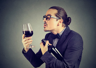 Funny man in love with wine