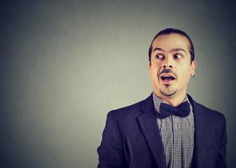 Surprised man listening to gossips