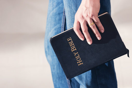 Man Holding Bible to His Side