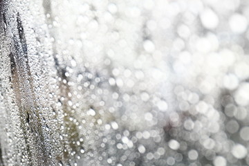 Water drop fresh condensation on window glass texture, rainy season wet background cooling feels and cold, raindrops texture wet transparent bubble