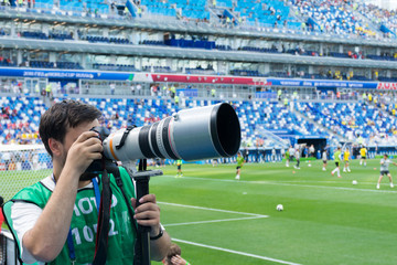 Football photojournalist looking for interesting shots.