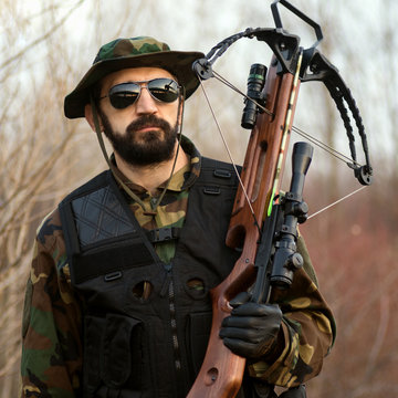 military man with crossbow