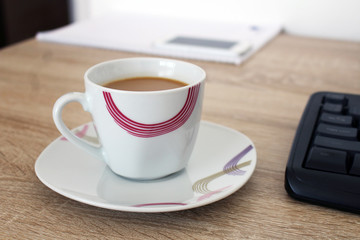Relax in work with coffee in cup
