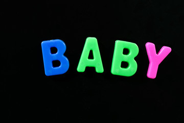 English letters in black background are the words baby