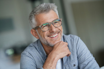 Middle-aged guy with trendy eyeglasses Wall mural