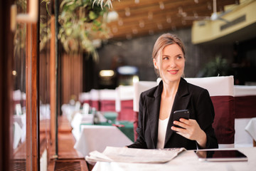 Smiling businesswoman sitting at a table