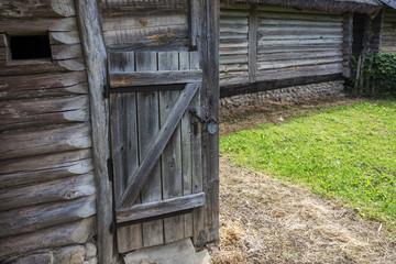 Wooden old door locked with a padlock