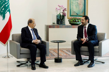 Lebanon's President Michel Aoun meets with Lebanese Prime Minister-designate Saad al-Hariri at the presidential palace in Baabda