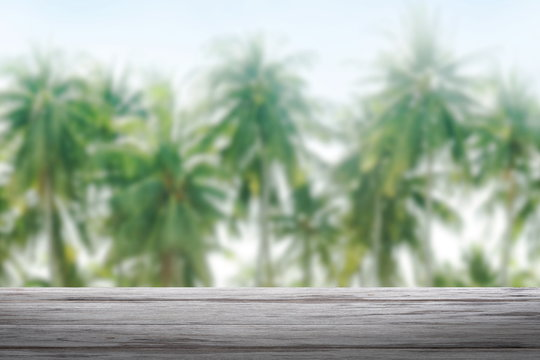 background coconut and wood plank, coconut palm tree background blurred and slats wooden texture floor plank table empty
