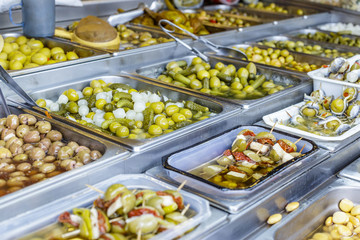 Various kinds of Olives at street Market in Spain.