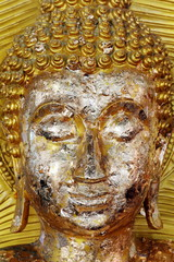 golden buddha face statue close-up, buddha statue