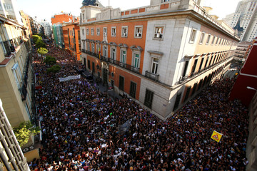 """Protesters attend a demonstration against the release on bail of five men known as the """"Wolf Pack"""" cleared of gang rape of a teenager and convicted of a lesser crime of sexual abuse in Madrid"""