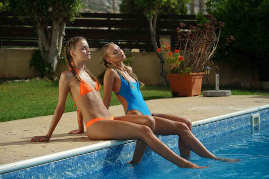 Two women by the swimming pool