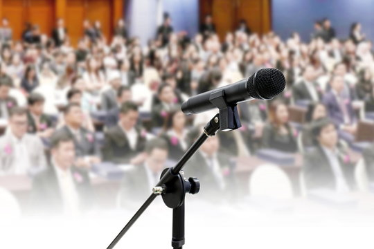 Microphone close up on Blurred many people seminar Meeting room business big hall Conference background