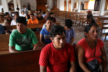 Liberated people and relatives sit in San Miguel church in Masaya