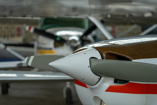Small Sport Aircraft parked in hangar, close up. detail