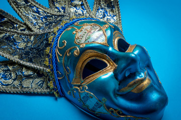 A blue Mardi Gras or carnival jester mask on a blue background Wall mural
